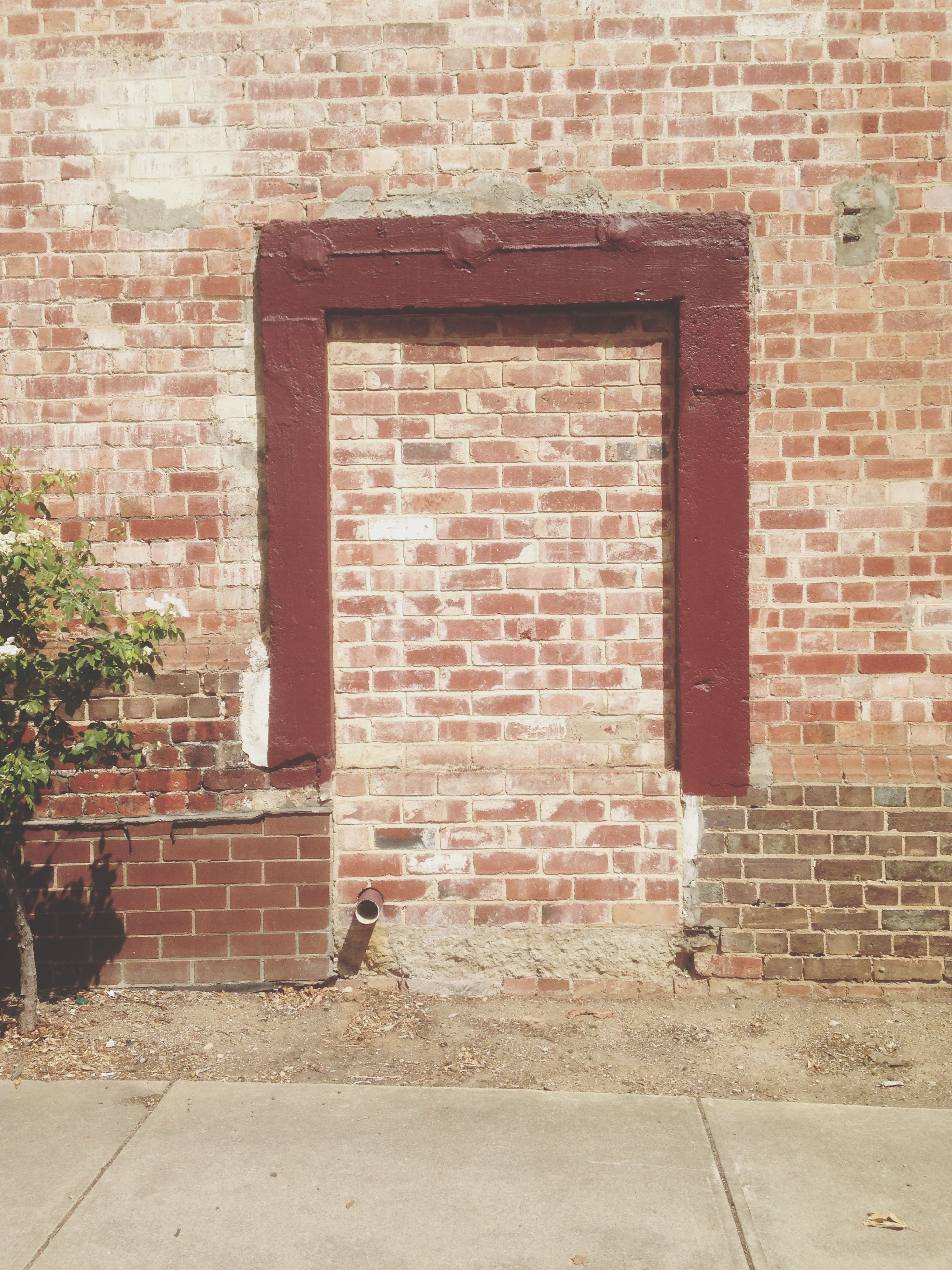 brick wall, architecture, built structure, building exterior, wall - building feature, stone wall, wall, red, brick, window, outdoors, day, no people, cobblestone, pattern, sunlight, old, closed, house, sidewalk