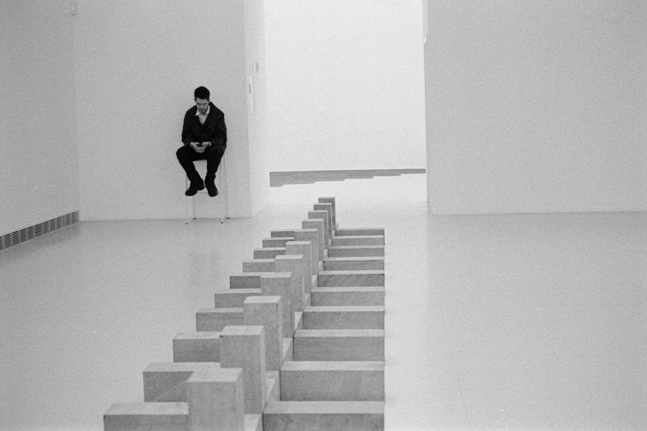 Black And White Photography Blackandwhite Emptyness Film Film Photography Filmisnotdeath Gallery Indoors  Modern Art Modern Art Gallery Sitting Man White Cube First Eyeem Photo