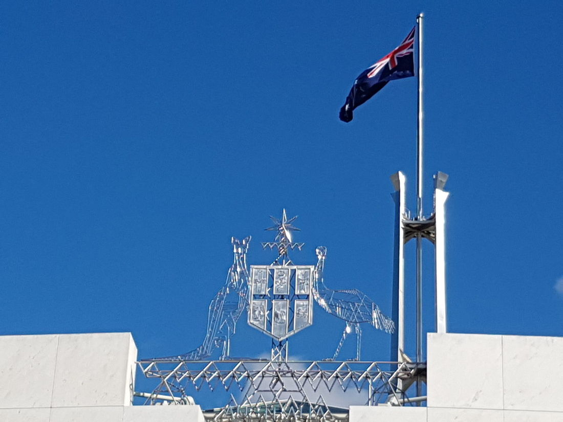 EyeEm Selects Patriotism Flag Blue Clear Sky Outdoors Politics And Government No People Sky Government Buildings Government Uncluttered Simple Canberra Parliament House Emblems Parliament House Canberra Parliament Building Australian Parliament Australia Australian Emblem  Clear Sky Day Emblem  Close-up