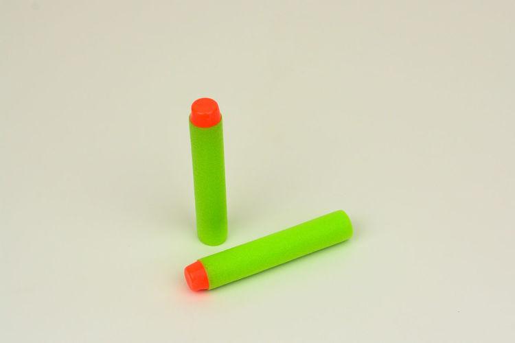 Green foam soft bullet for toy gun on white background Bullet For Toy Close-up Foam Bullet No People Soft Bullet Studio Shot Toys White Background
