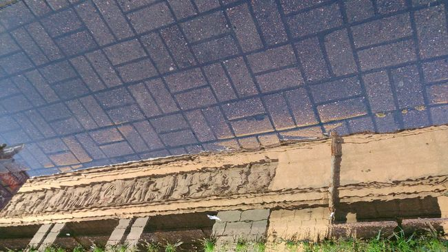 Relief Reflection . Mobile Photography Mobilephotography Sony Xperia Zr Unusual Perspective Unusual View Flipped Reflections Reflections In The Water Puddle Puddle Reflections Water Reflections Water Architecture Architectural Detail Architecture Photography Old Town Old Buildings Old Building  Old Architecture