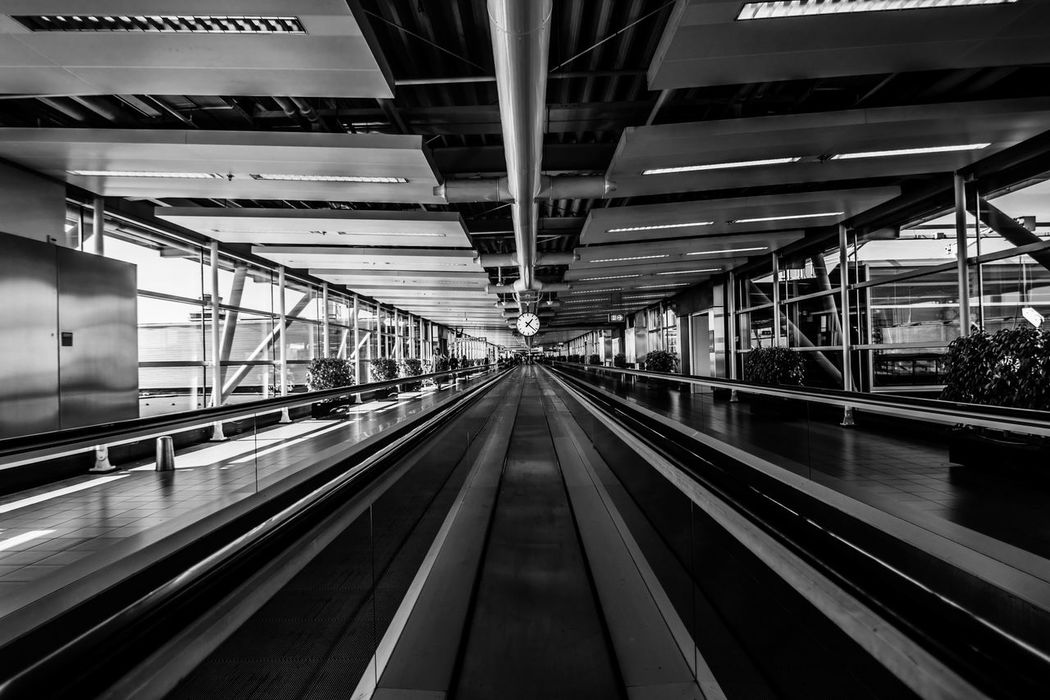 Airport Amsterdam Architecture Built Structure City Life Clock Connection Convenience Diminishing Perspective Electric Light Engineering Escalator Indoors  Leading Lines Long Modern Moving Walkway  Railing Schipolairport Technology The Way Forward Transportation Travel Destinations Vanishing Point
