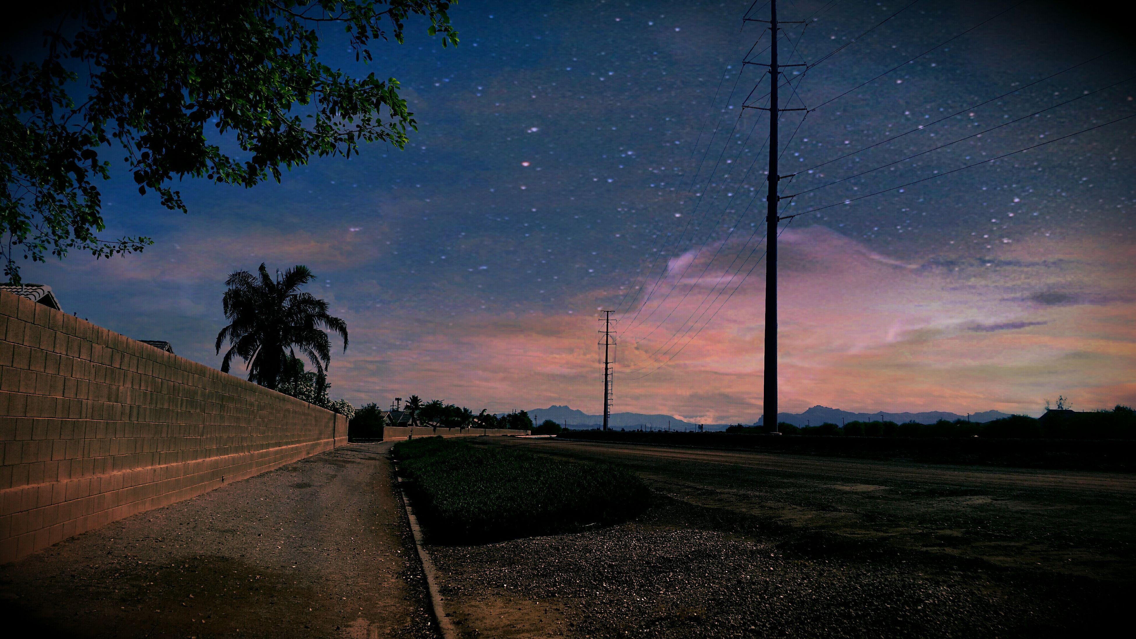 sky, road, the way forward, night, cloud - sky, landscape, street, transportation, street light, tree, illuminated, nature, sunset, tranquility, scenics, field, empty road, road marking, tranquil scene, outdoors