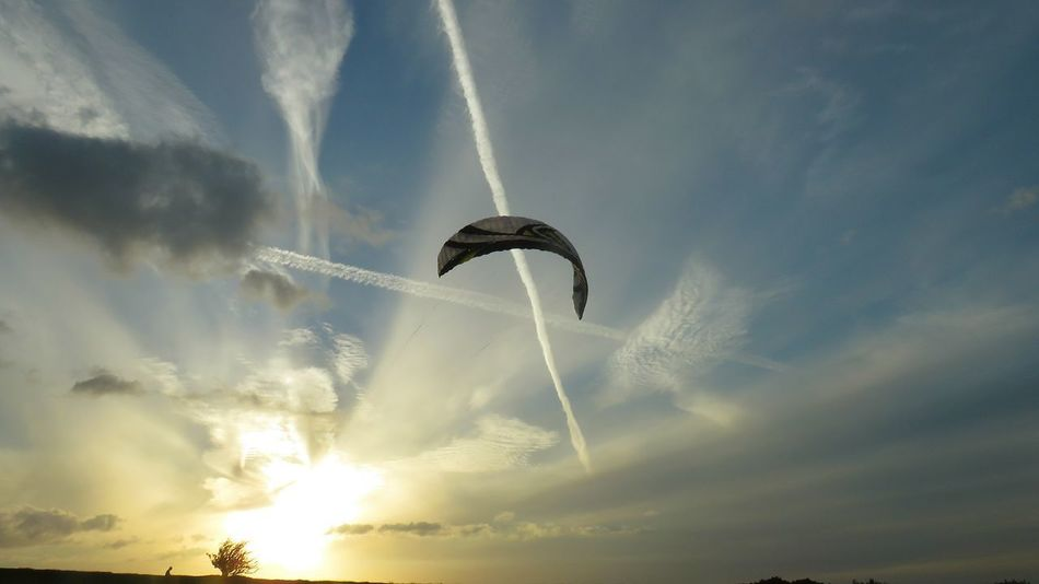 Mid-air Low Angle View Beauty In Nature Cloud - Sky Flying Vapor Trail Spread Wings Airshow No People Outdoors Motion Paragliding Aerobatics Sunlight