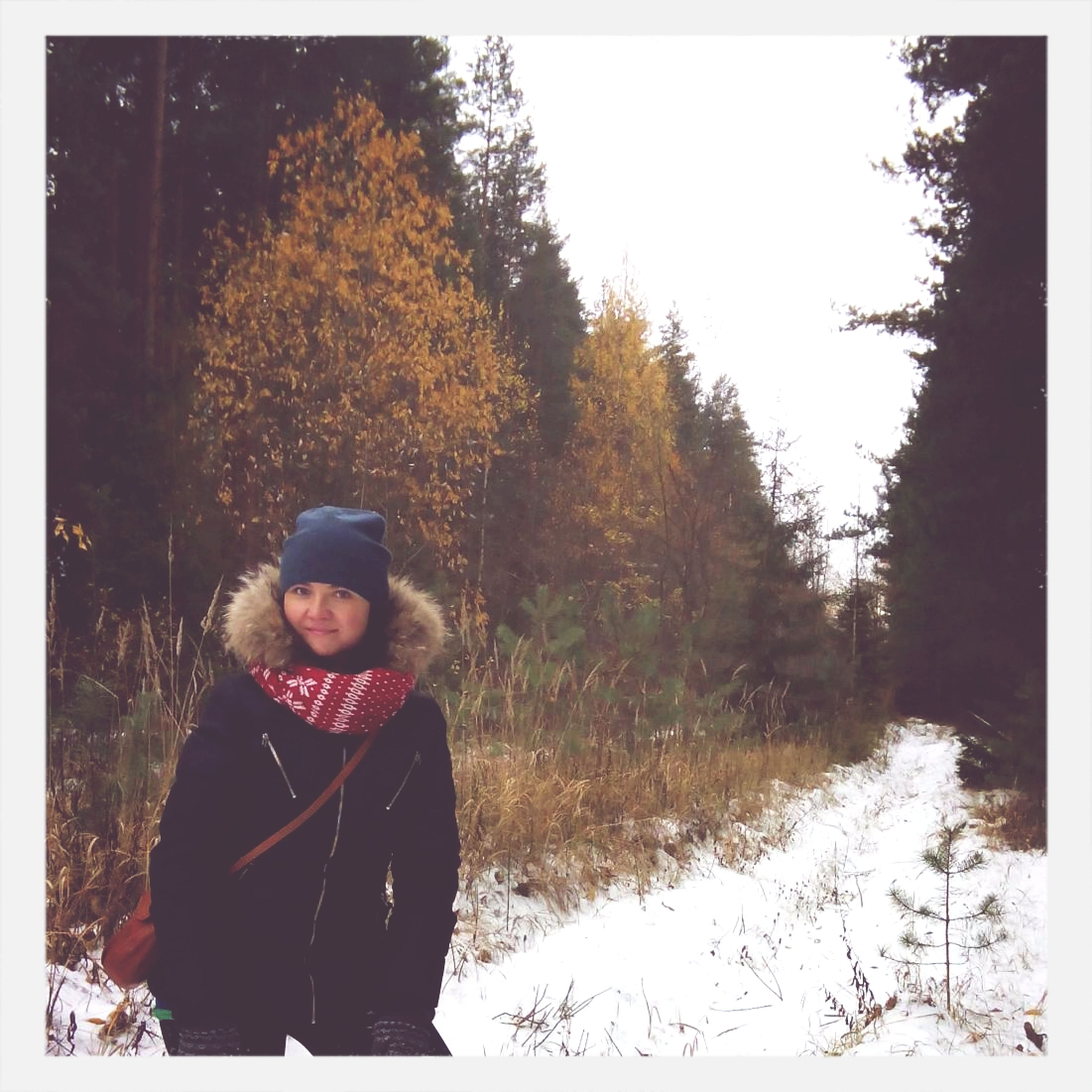 winter, snow, cold temperature, season, lifestyles, leisure activity, tree, transfer print, warm clothing, person, standing, auto post production filter, weather, field, nature, tranquility, casual clothing, clear sky