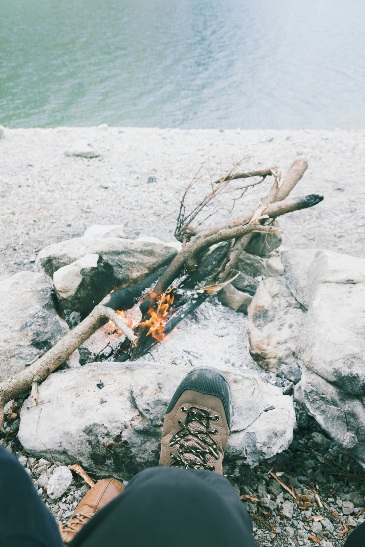 hiking shoes in front campfire Adventure Bonfire Burning Campfire Flame Hiking Hiking Shoes Lifestyles Nature Outdoor Outdoors Relaxing Shoe Water