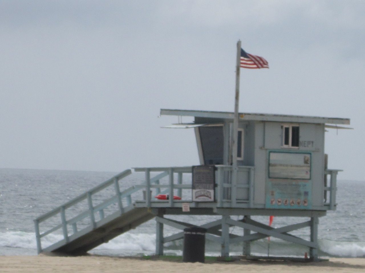 flag, sea, horizon over water, water, lifeguard hut, patriotism, day, no people, scenics, built structure, sky, outdoors, clear sky, beach, nature, beauty in nature, architecture