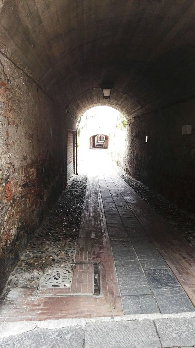 Absence Albenga Arch Architecture Architecture Archway Building Built Structure Ceiling Corridor Diminishing Perspective Empty Illuminated Indoors  Italy Lighting Equipment Narrow No People The Way Forward Tunnel Tunnel Vision Vanishing Point Walkway Wall - Building Feature