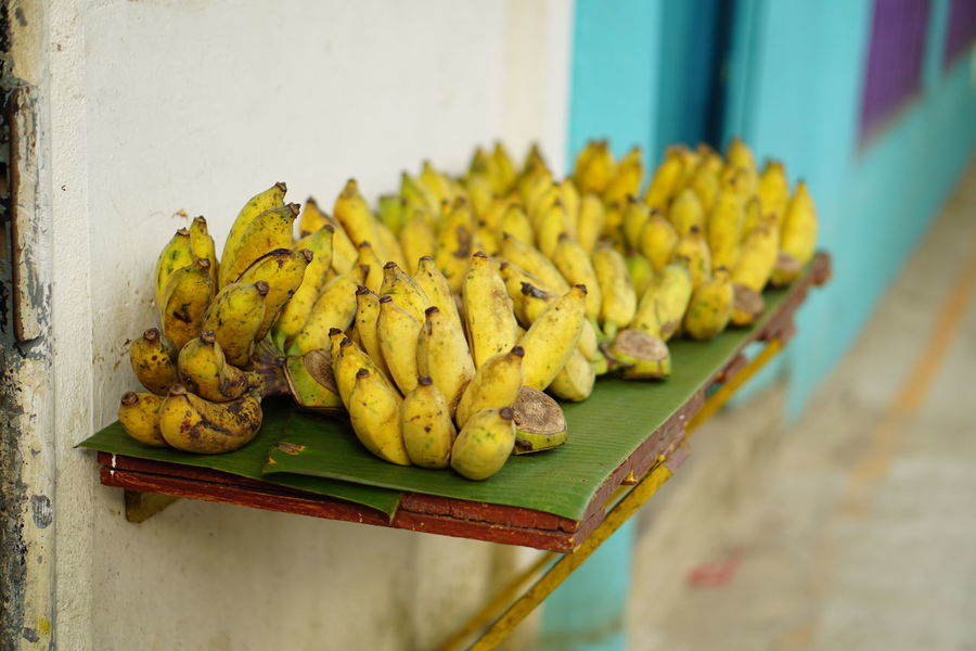 Bananas for sell along the walk path Bananas For Sale Crafted Beauty Food No People Healthy Eating Yellow Travel Destinations Day Banana Leaf Outdoors Freshness Close-up