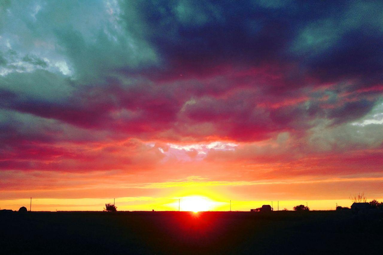 sunset, silhouette, orange color, dramatic sky, sky, cloud - sky, sun, beauty in nature, scenics, tranquil scene, nature, sunbeam, atmospheric mood, majestic, tranquility, idyllic, no people, outdoors, landscape, field, awe, sunlight, rural scene, tree