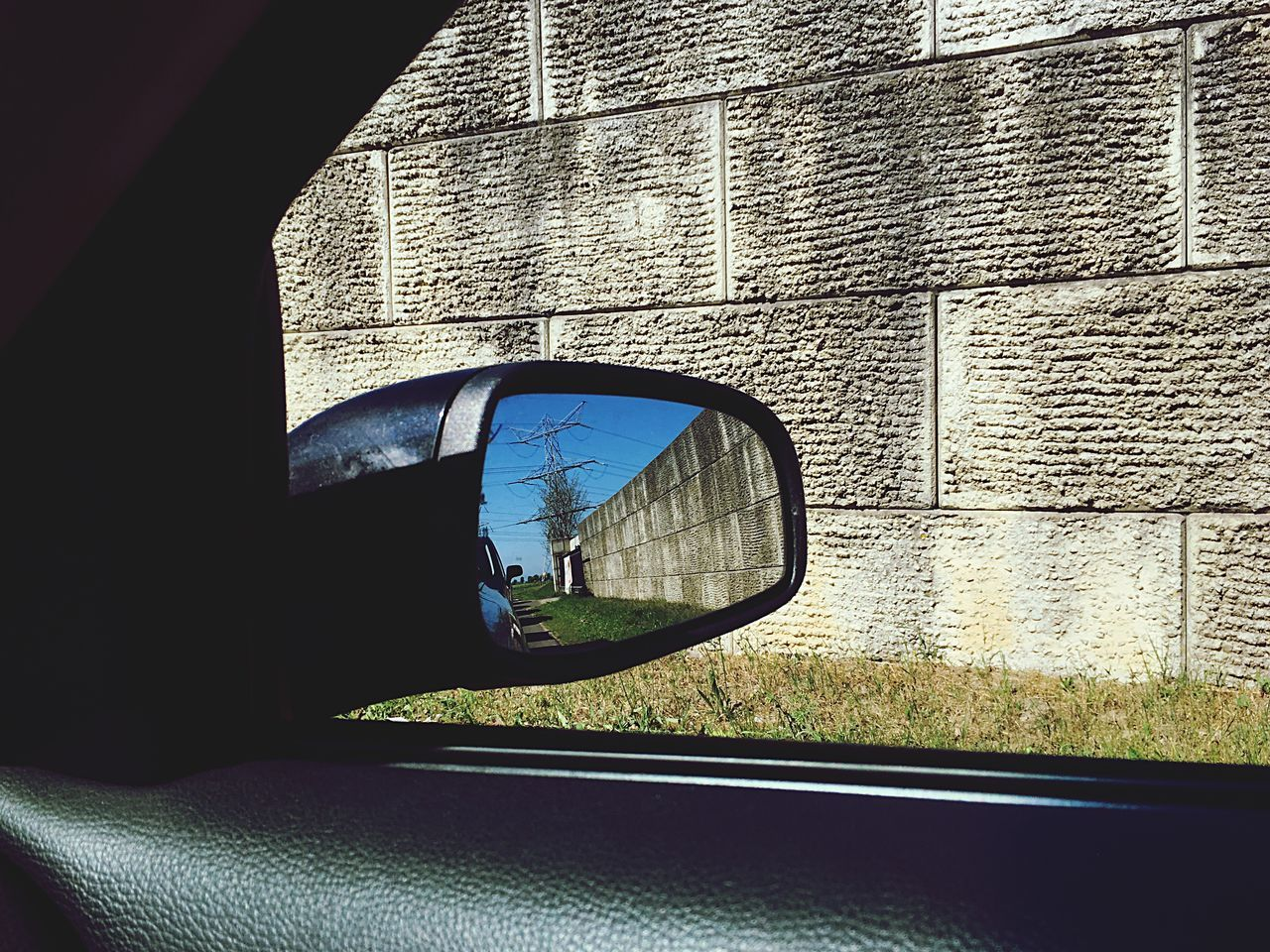 The Wall Side-view Mirror Transportation Reflection Window Vehicle Mirror Mode Of Transport Mirror Car Land Vehicle Day Sunlight Road One Person Real People Architecture Road Trip Built Structure Outdoors People Iphonephotography IPhoneography