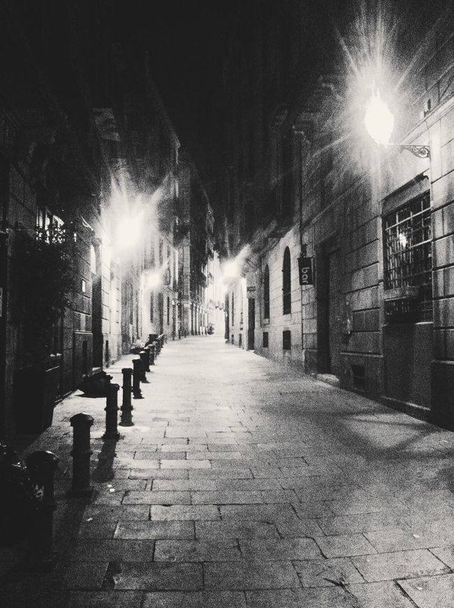 Alley Architecture Barcelona Barri Gótic Building Exterior Built Structure City Cobblestone Diminishing Perspective Empty Film Noir Footpath Illuminated Lens Flare Lighting Equipment Long Medieval Narrow Night Old Town Street Street Light The Way Forward Vanishing Point Walkway