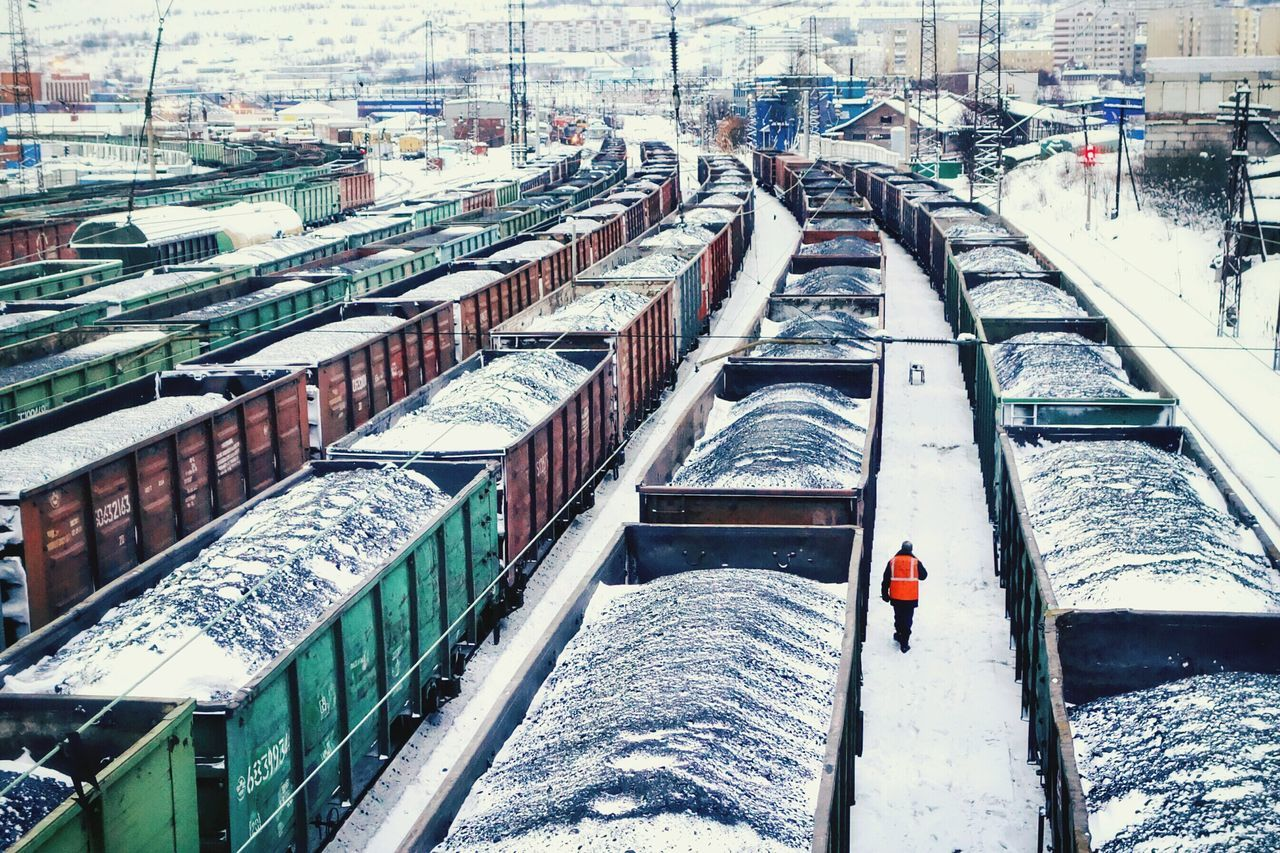 High Angle View Of Snow Covered Cargo Containers At Station