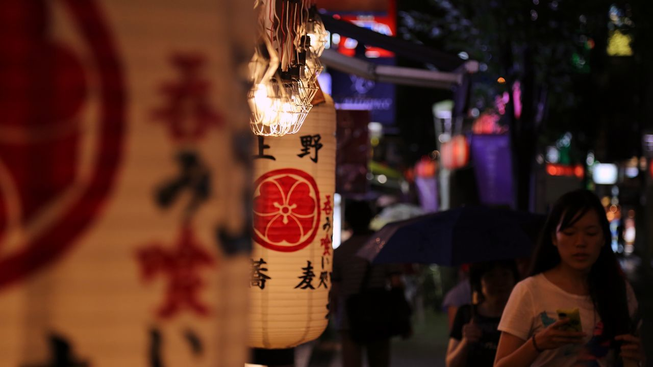 text, communication, hanging, focus on foreground, night, paper lantern, lantern, outdoors, real people, illuminated, close-up