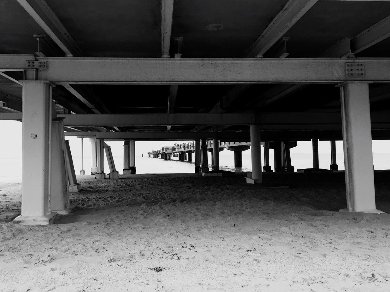 underneath, sand, architecture, below, bridge - man made structure, built structure, beach, strength, architectural column, indoors, no people, day