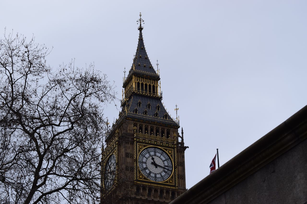 Clock Clock Tower Tower Architecture Low Angle View Travel Destinations Building Exterior City Time Travel Built Structure Outdoors No People Cultures Sky Bare Tree Day Tree Clock Face Hour Hand London Bigben Adapted To The City