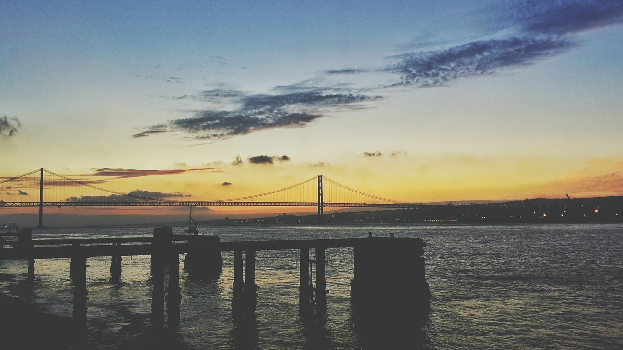 sunset, water, silhouette, sea, sky, beauty in nature, tranquil scene, scenics, nature, cloud - sky, tranquility, outdoors, no people, built structure, architecture, horizon over water, day