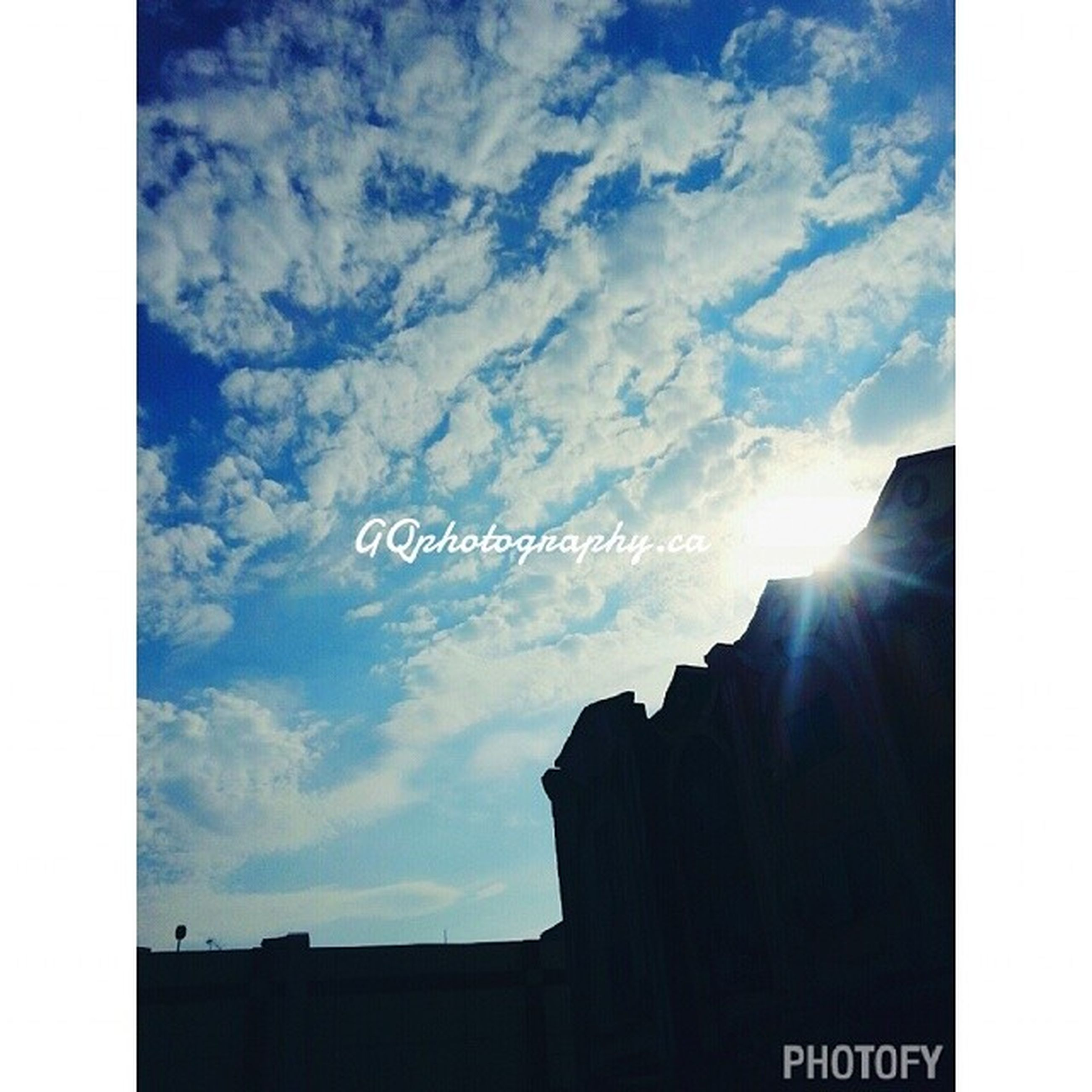 transfer print, sky, silhouette, auto post production filter, cloud - sky, sun, sunbeam, low angle view, sunlight, cloud, building exterior, built structure, architecture, sunset, blue, nature, outdoors, scenics, beauty in nature, no people