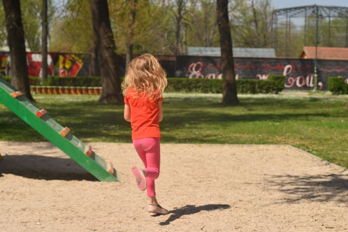 Russian girl playing in the playgorund. She is running to take water from the fountain to build her castle. Following Showcase: April Pastel Colors Playground Park Streetphotography Running Girl Street Photography Showcase April The Street Photographer - 2016 EyeEm Awards The Following