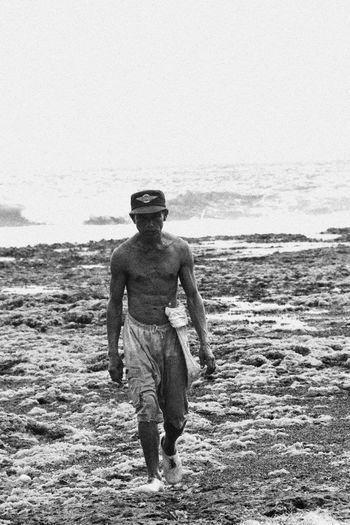 the old man Beach Black White And Color Gunung Kidul, Yogyakarta INDONESIA Men People Life  Real People Yogyakarta