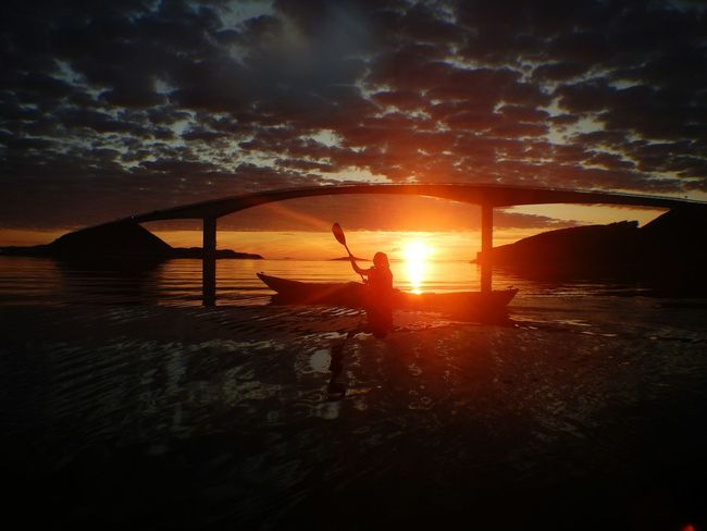 Kayaking under the Atlantic Road. Sunset Water Scenics Tranquil Scene Outdoors Paddling Kayak Kayaker Norway Visitnorway Watersports Averøy Majestic Sunbeam Orange Color Reflections In The Water Dramatic Sky Non-urban Scene