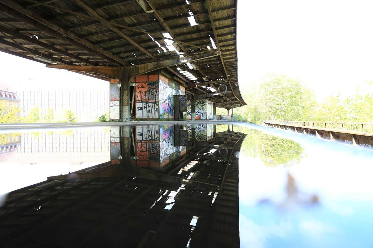 architecture, built structure, reflection, water, no people, day, indoors, building exterior, architectural column, puddle, tree, nature, sky
