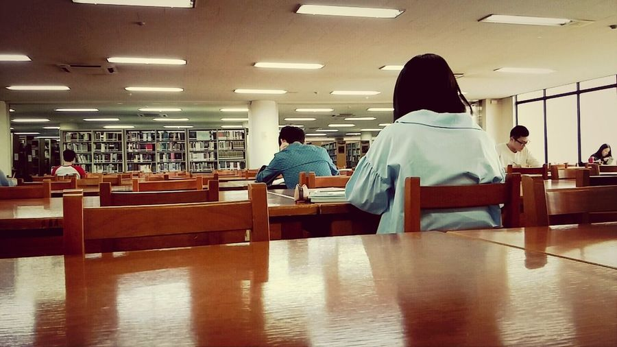 In Library Reading A Book