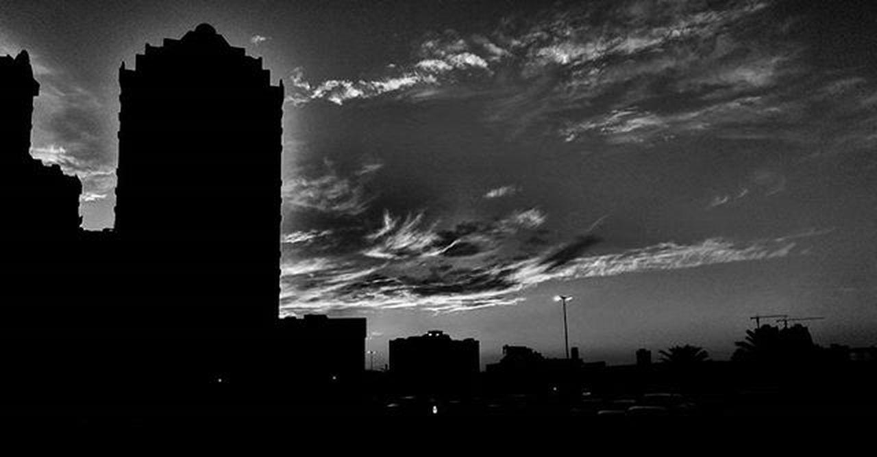 architecture, built structure, building exterior, silhouette, city, skyscraper, cloud - sky, no people, sky, travel destinations, outdoors, cityscape, urban skyline, storm cloud, nature, night, tree