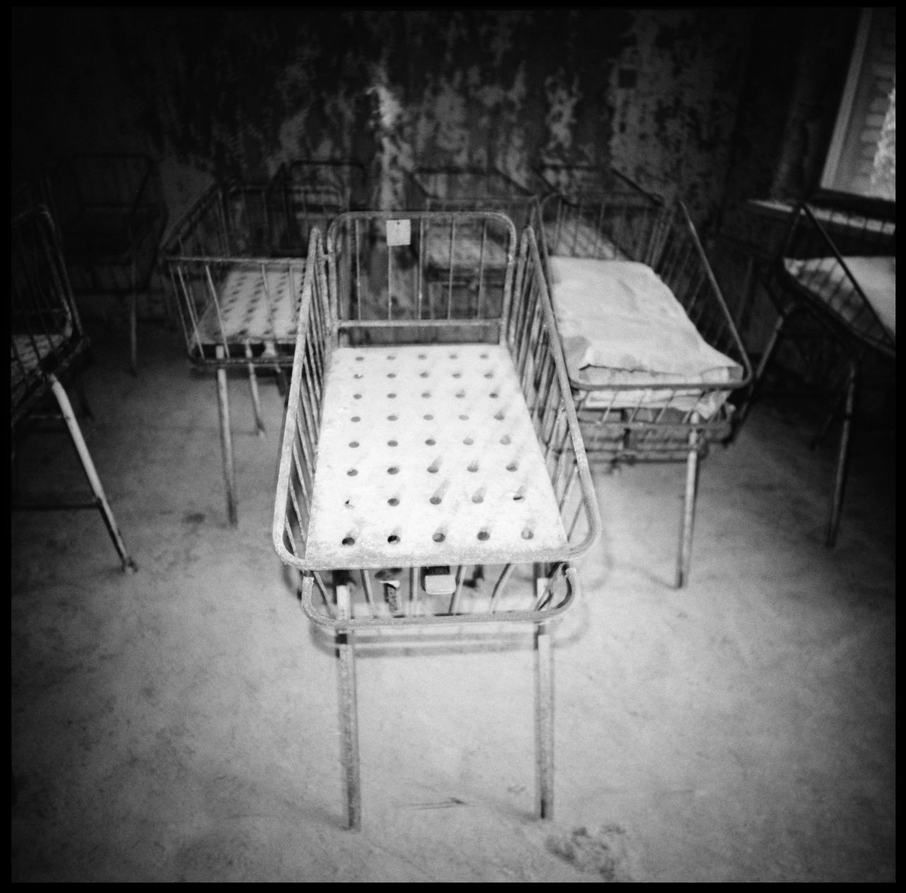 The pedeatric department of the abandonded hospital in Pripyat Abandonded Abandonded Baby Cradly Abandonded Building Abandonded Hospital Analogue Photography Baby Cradle Black And White Photography Chernobyl Chernobyl Catastrophy Chernobyl Exclusion Zone Clinic Cyrilic Death Eerie Clinic Indoors  No People Nuclear Blast Pediatrics Pot Pripyat Pripyat Hospital Scary Hospital Soviet Union Spooky Hospital White Wash The Photojournalist - 2017 EyeEm Awards The Photojournalist - 2017 EyeEm Awards