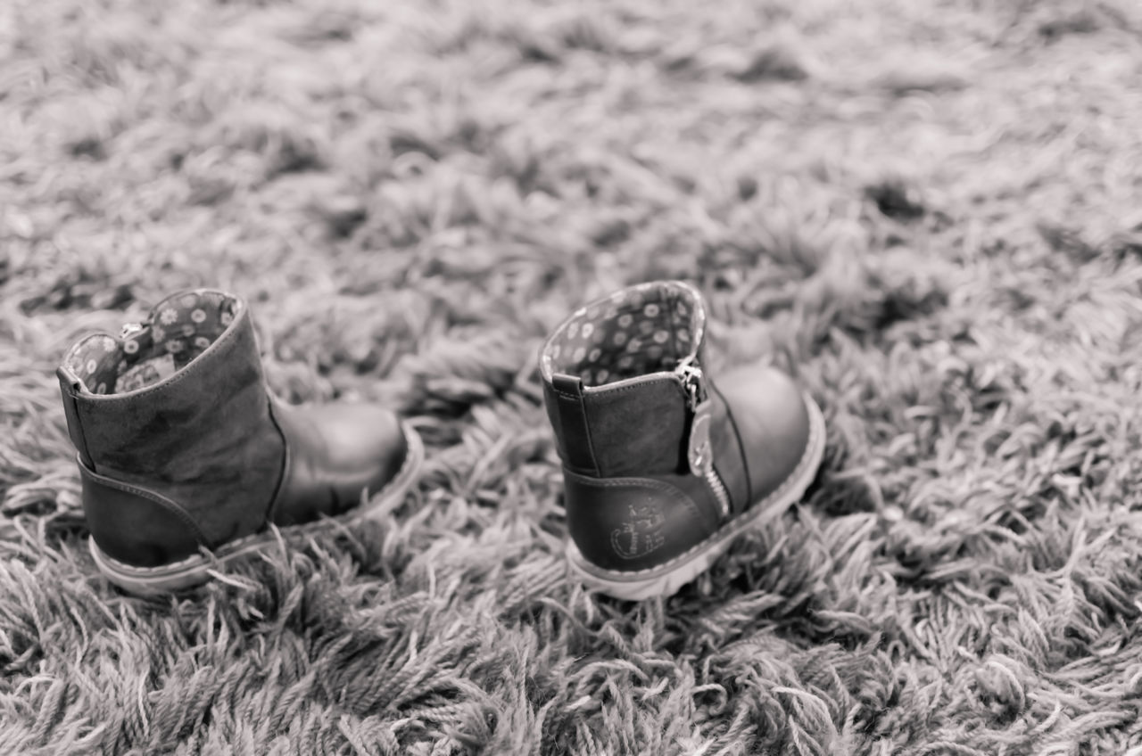 steps Black And White Blackandwhite Bokeh Bokeh Photography Boot Boots Boots❤ Carpet Child Shoes Close-up Day Field Focus On Foreground Freshness No People Outdoors Shoe Shoes Zipper