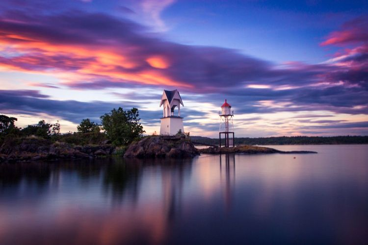 Calm summer evening by the sea Check This Out Norway Langesund Long Exposure Summer Sunset Water Water Reflections Sea Clouds And Sky Lighthouse Lighthouse_lovers