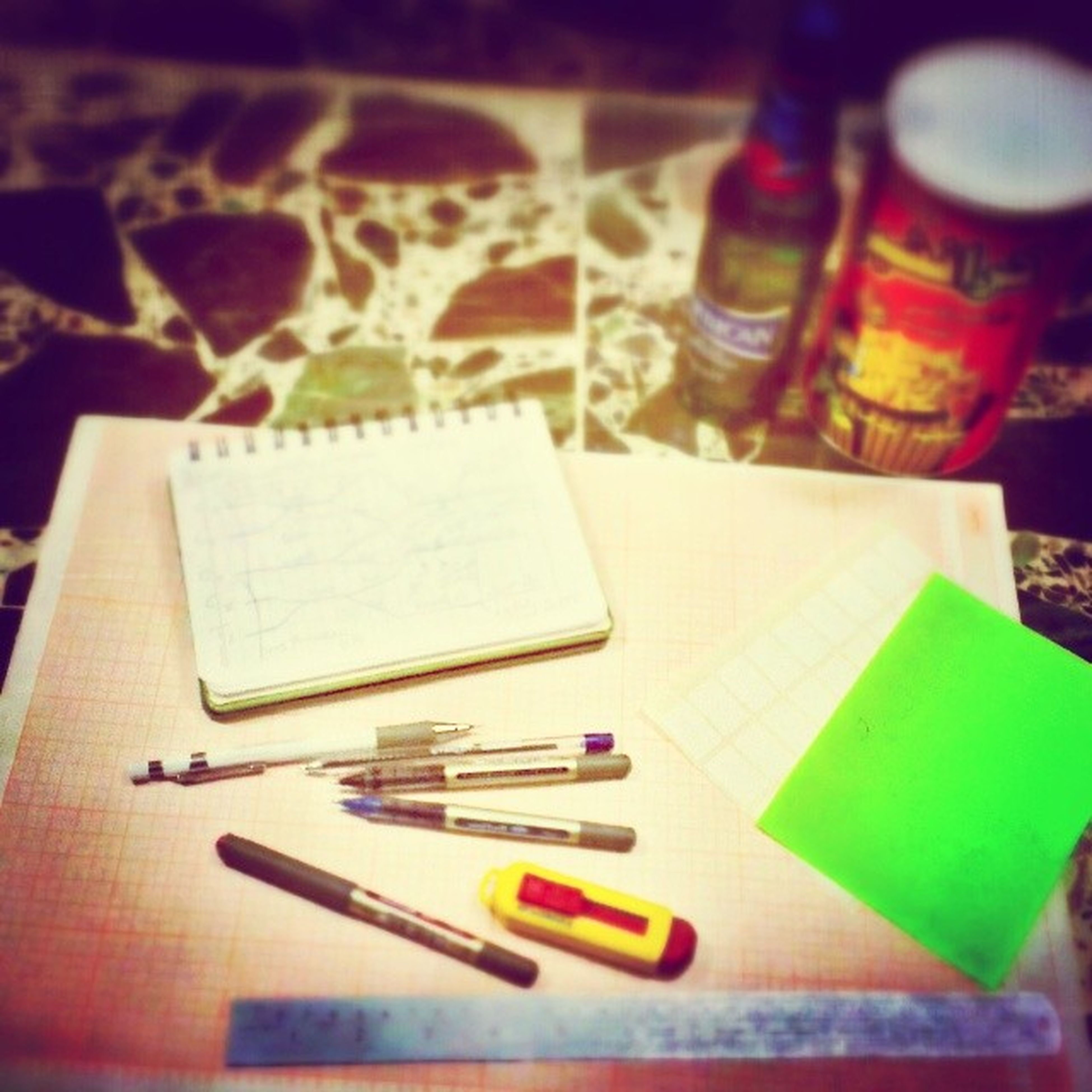 indoors, still life, table, pencil, pen, close-up, book, paper, high angle view, education, multi colored, variation, selective focus, office supply, plastic, choice, colored pencil, art and craft, no people, large group of objects