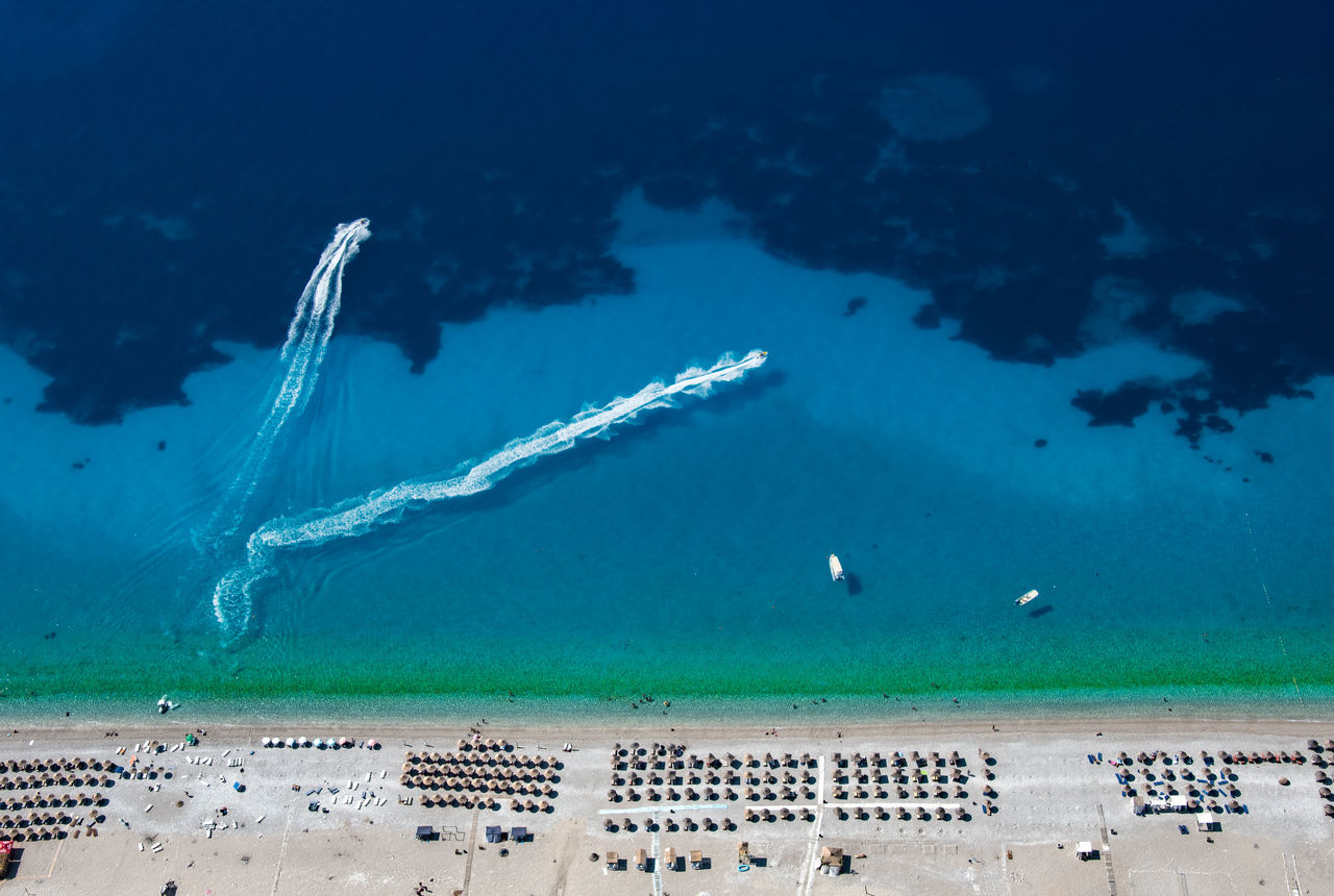 Albania beach blue day dhërmi From above Holiday Mediterranean Natural Pattern nautical vessel no people outdoors Paragliding sand scenics sea shades of blue tourquise tranquil scene Tranquility Travel vacation water Fresh on Market 2017
