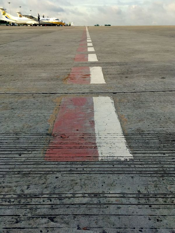 A border (safety line) or a line at the end of safety zone Yangoninternationalairport Aircraftmechanic Memories Eyem Team Bestphoto ATR72 Aircraft Airplane Smartphonephotography Enjoying Life ATR72 600 AirKBZ