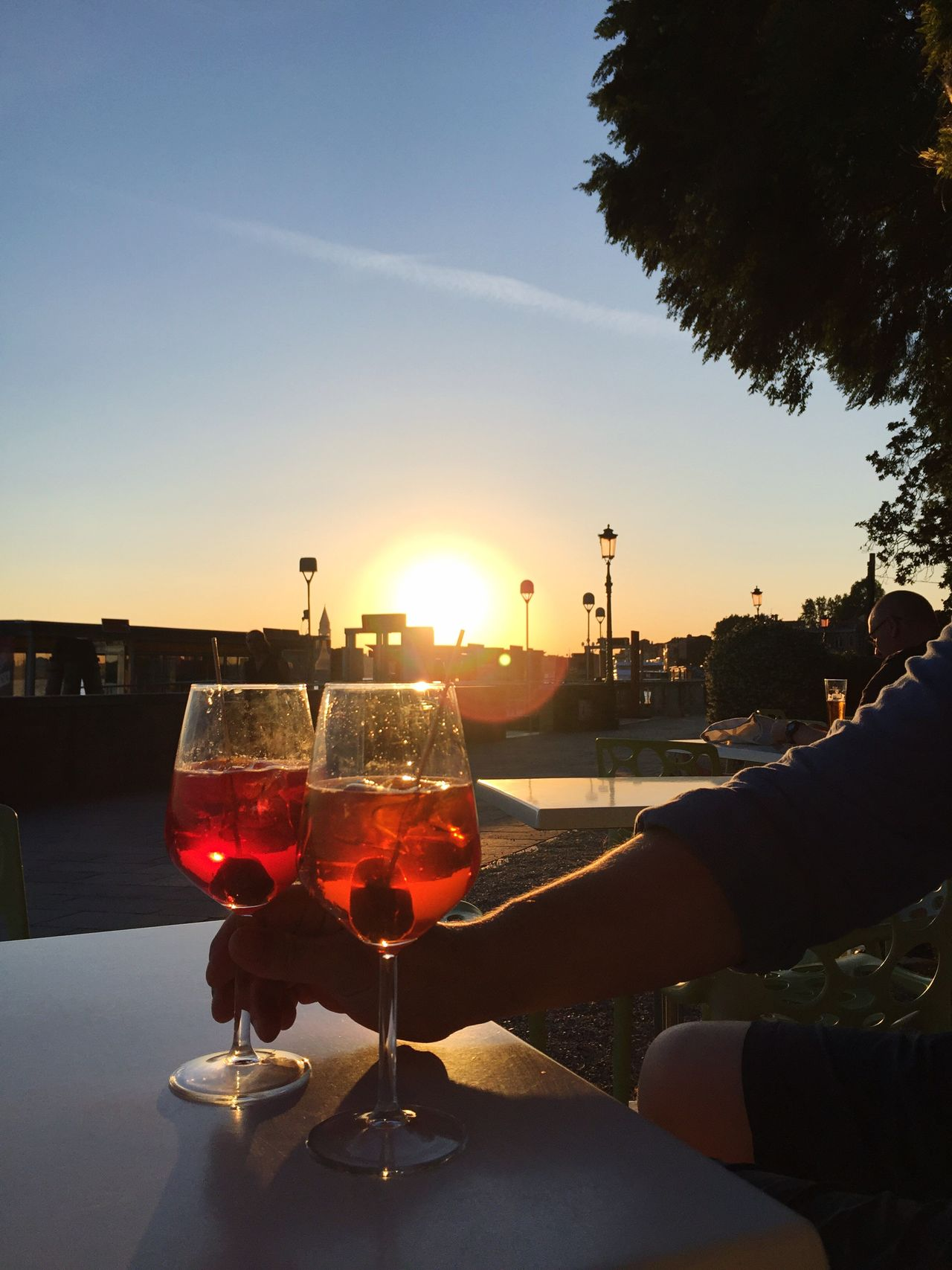 Aperitivo at sunset in Venice Food And Drink Drink Alcohol Refreshment Sunset Wine Wineglass Real People Sun Table Human Hand Drinking Glass Sky Two People Sunlight Close-up Men Freshness Food Outdoors Spritz Time  Aperol Spritz Venice Sunset_collection Togetherness