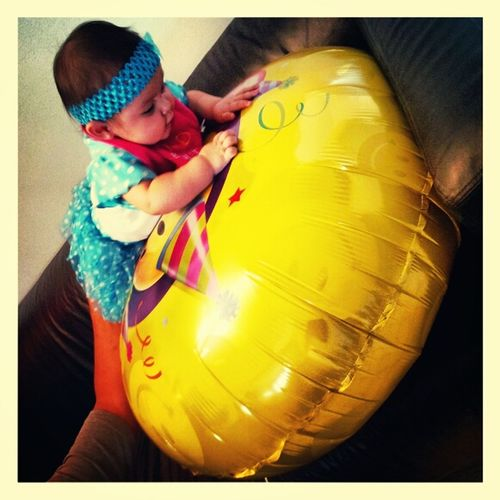 my baby playing with my sisters ballon