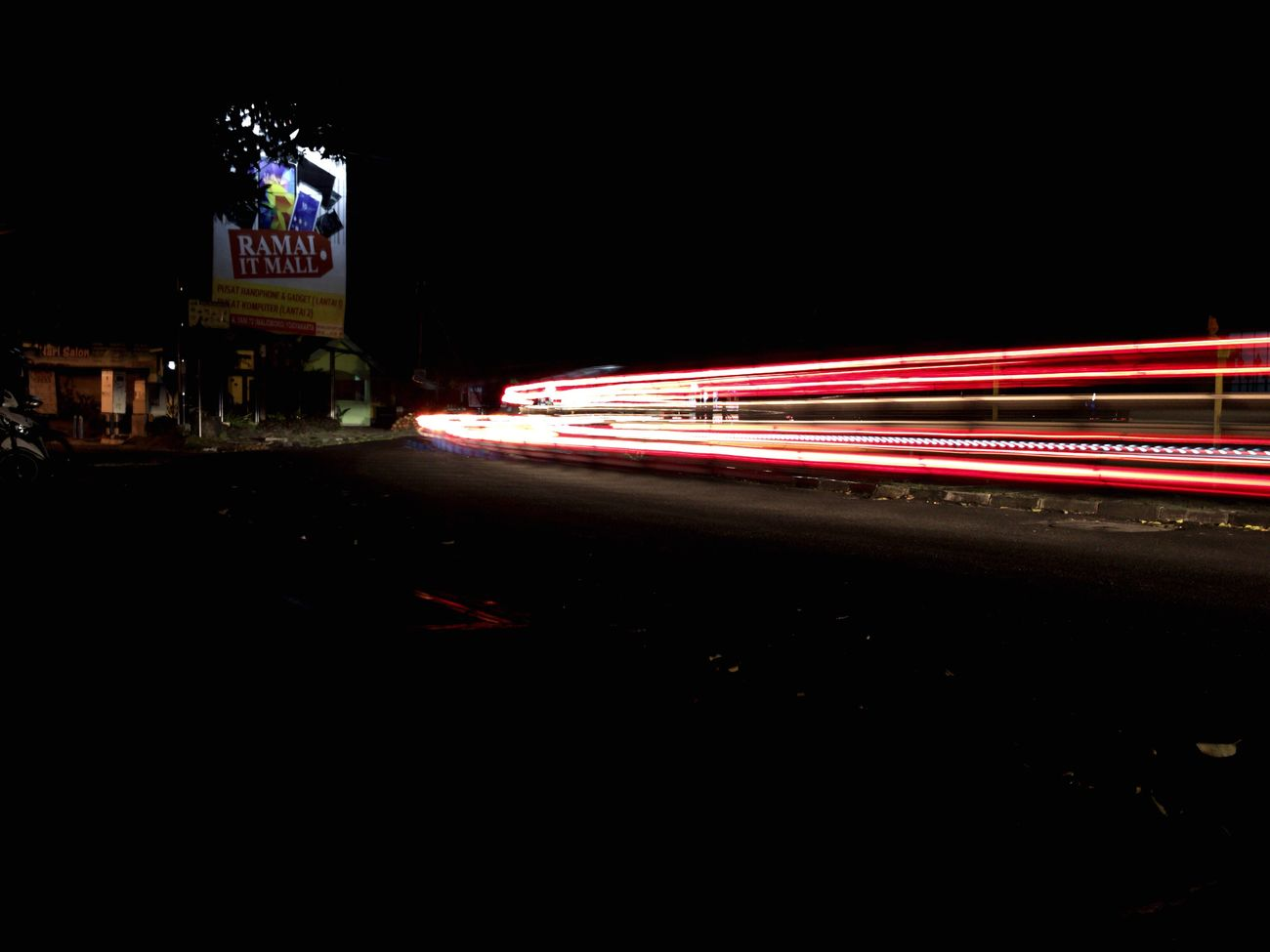 Night photograph. Illuminated Long Exposure Night Light Trail Neon Outdoors Speed Slowshutterphotography Slowshutter Kind Of Night Slowshutters IPhoneography