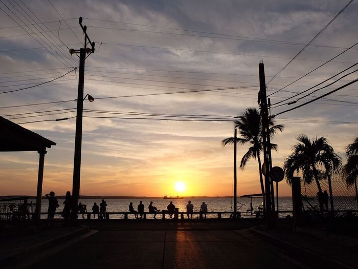 Sunset at Cienfuegos Malecón in Cuba 🇨🇺 Sunset Sky Palm Tree Silhouette Sea Cloud - Sky Cable Sun Tree Nature Beauty In Nature Beach Water Horizon Over Water Outdoors Scenics No People Day The Street Photographer - 2017 EyeEm Awards Cuba Cienfuegos, Cuba Live For The Story Sommergefühle Mix Yourself A Good Time Lost In The Landscape