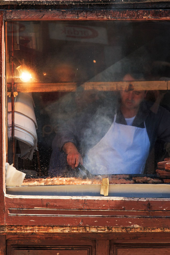 Man cooking kebaps in Skopje, Macedonia Auto Post Production Filter Balkans Casual Clothing East Europe Food And Drink Macedonia Reflection Retail  Shop Skopje