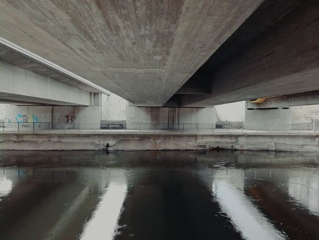 Built Structure Water No People Day Outdoors Concrete Structure Bridges Under The Bridge Graffiti River Grey Scale Springtime Architecture Lines And Shapes Dark And Light Solid Plain Vacant The Secret Spaces