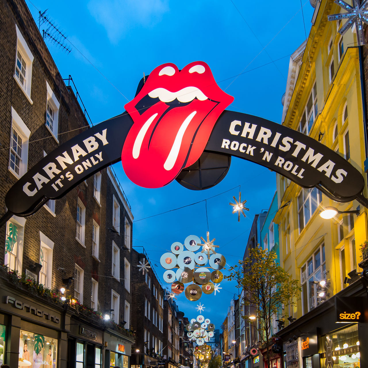Architecture Blue Blue Sky Building Exterior Carnaby Christmas Carnaby Street Christmas Christmas Lights City Cultures EyeEm From My Point Of View Lights London Night No People Outdoors Red Rocknroll Rolling Stones Signs Sky Tongue Travel Destinations Vacations