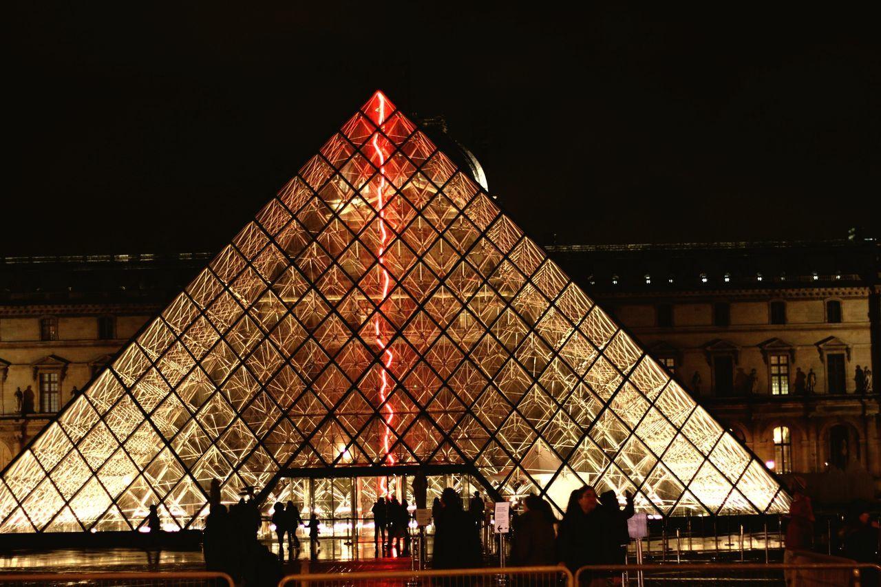 Illuminated Louvre Pyramid At Night