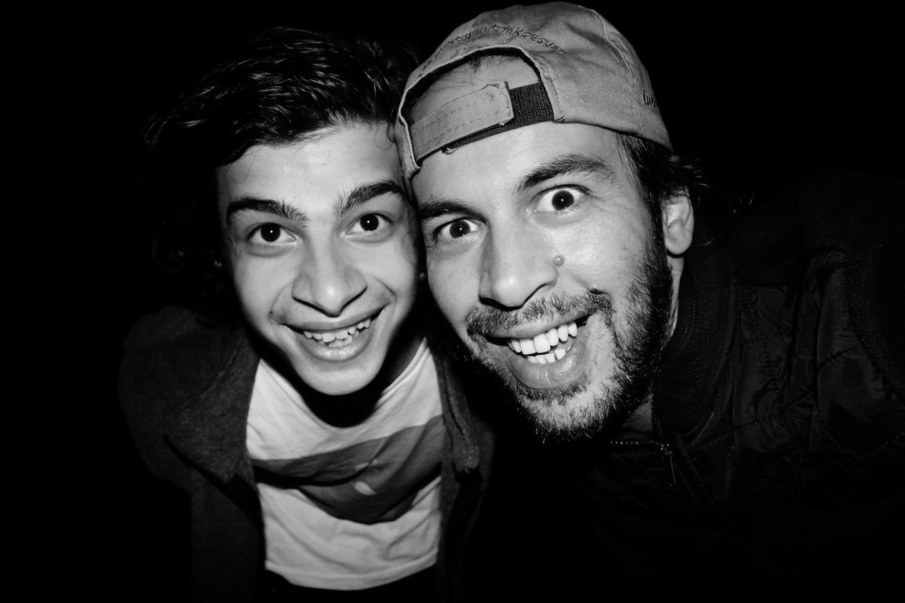 EyeEm Selects EyeEmNewHere Looking At Camera Portrait Two People Happiness Togetherness Smiling Black Background Young Adult Cheerful Headshot Young Men Young Women Real People Men Selfie Indoors  Close-up Photography Themes Adult Friendship