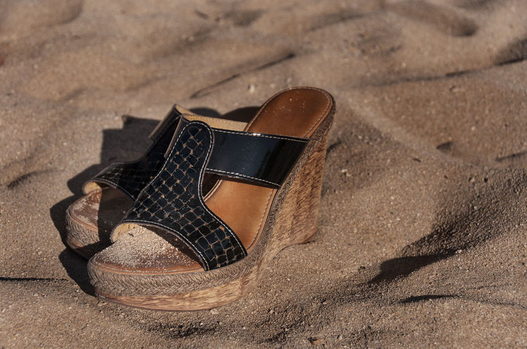 Abandonment Lonely Shoe Lonliness No People Outdoors Relaxation Time Sand In My Shoes Sand In My Toes Sandy Beaches Sandy Shoes Selective Focus Shadows In The Sand Shoes At The Beach Shoes In Sand Shoes In The Sand Shoes Off Summer Fun Vacation At The Beach Wedges In The Sand Weekend Ready