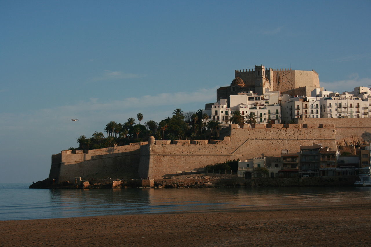 "Fantastic old town built within the castle walls; ""Game of Thrones"" place in Spain. Architecture Built Structure Castle Castle Garden Castle View  Castle Walls Castle Walls, Mediterranean Sea Sea Sky Water"