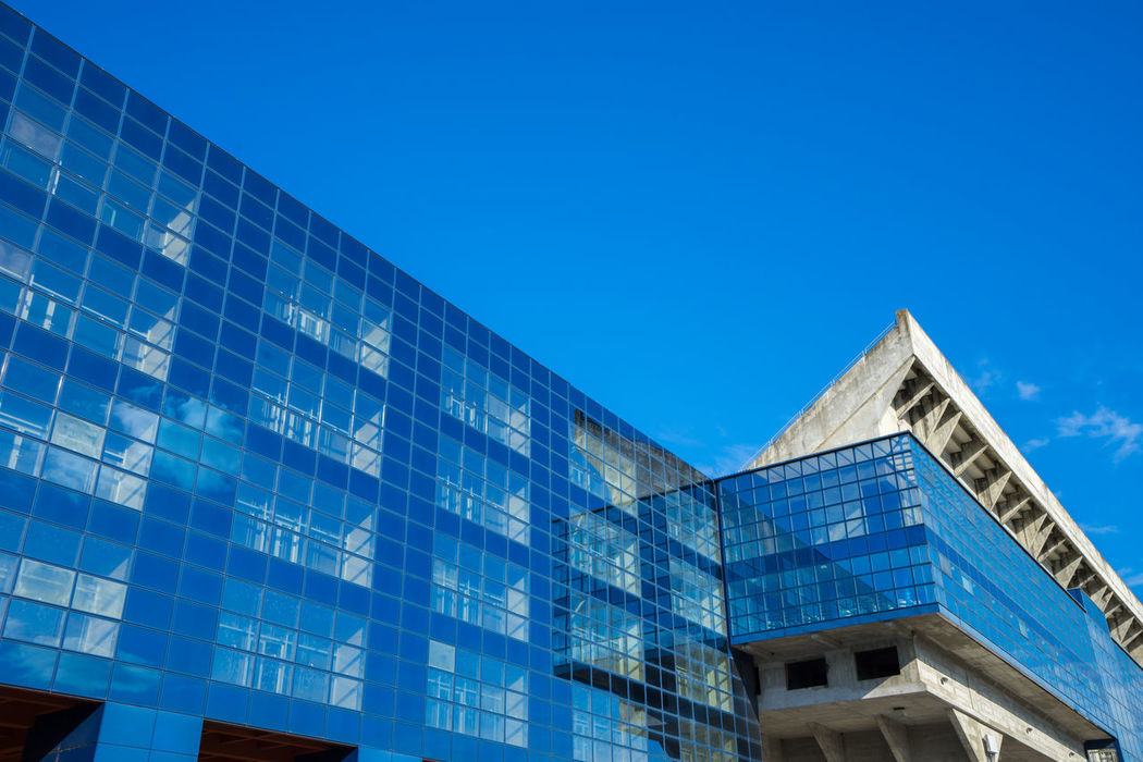Architecture Blue Building Building Exterior Built Structure City City Life Day Dinamo Dinamo Arena Football Football Stadium High Section Low Angle View Modern No People Office Building Outdoors Relfection Repetition Sky Tall - High Window Windows