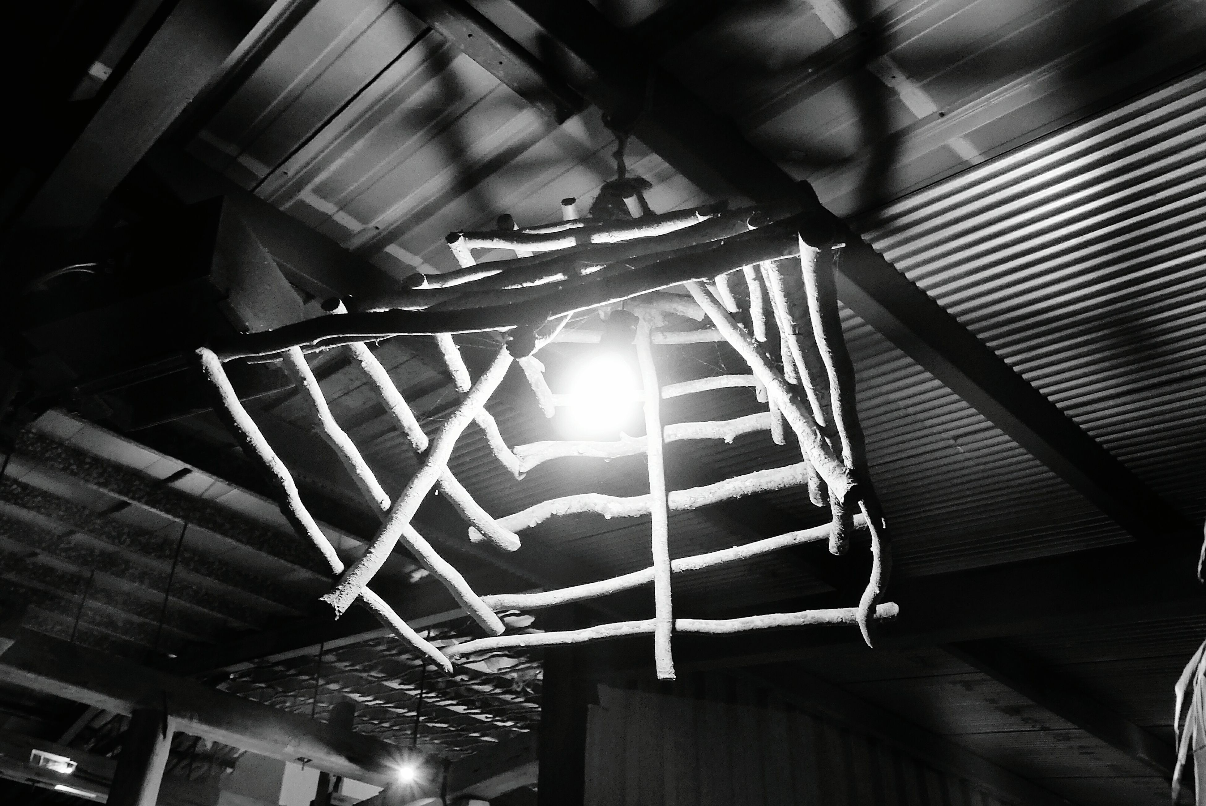 indoors, illuminated, ceiling, low angle view, lighting equipment, hanging, built structure, architecture, night, pattern, in a row, light - natural phenomenon, no people, electric light, decoration, glowing, electricity, design, electric lamp, repetition