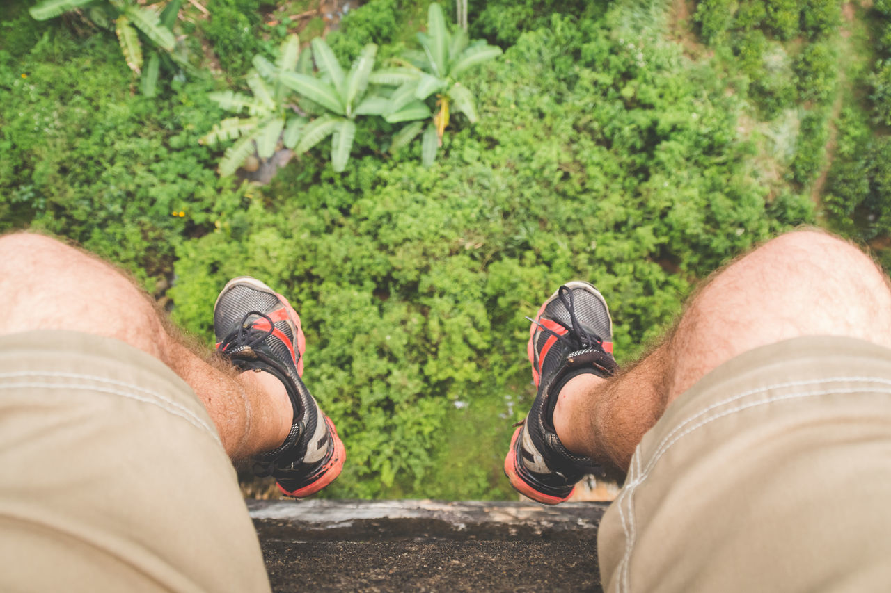 Holiday Travel Adult Day Feet Hanging Over Human Body Part Human Leg Lifestyles Low Section Men Nature One Person Outdoors Personal Perspective Real People Shoe Standing Travel Destinations Vacation