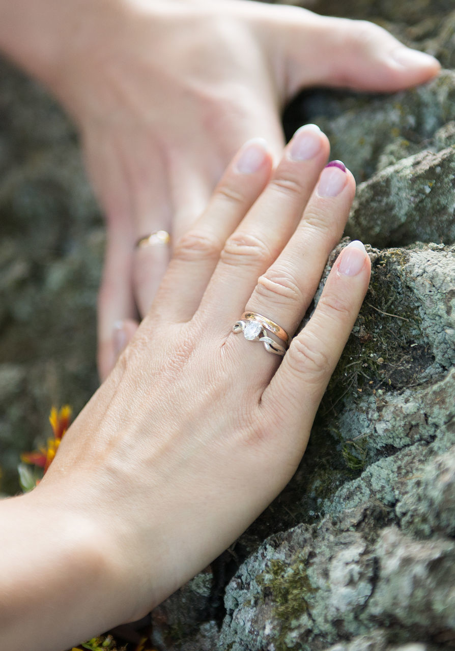 human hand, two people, real people, human body part, women, men, close-up, love, rock - object, togetherness, couple - relationship, day, outdoors, bonding, lifestyles, married, adult, people