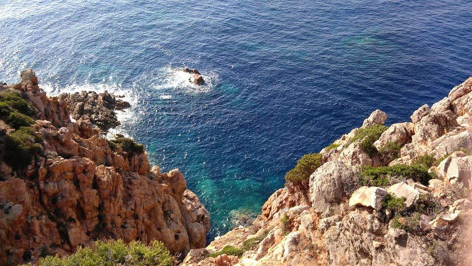 Arid Climate Cliff Coast Coastline Day Geology Geometry Horizon Over Water Outdoors Physical Geography Power In Nature Rock Rock - Object Rock Formation Rocky Rough Sardegna Scenics Sea Water